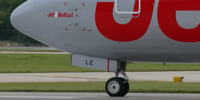 Airliner registration number on the nosewheel door on the front landing gear